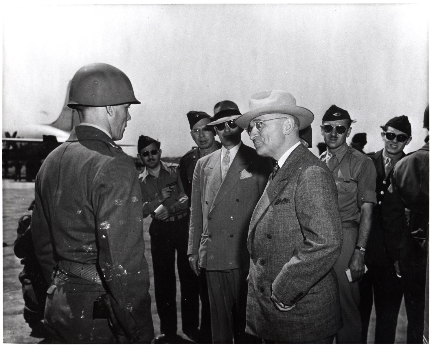 President Harry Truman visits with American troops [perhaps during his trip to Germany for the Potsdam Conference].