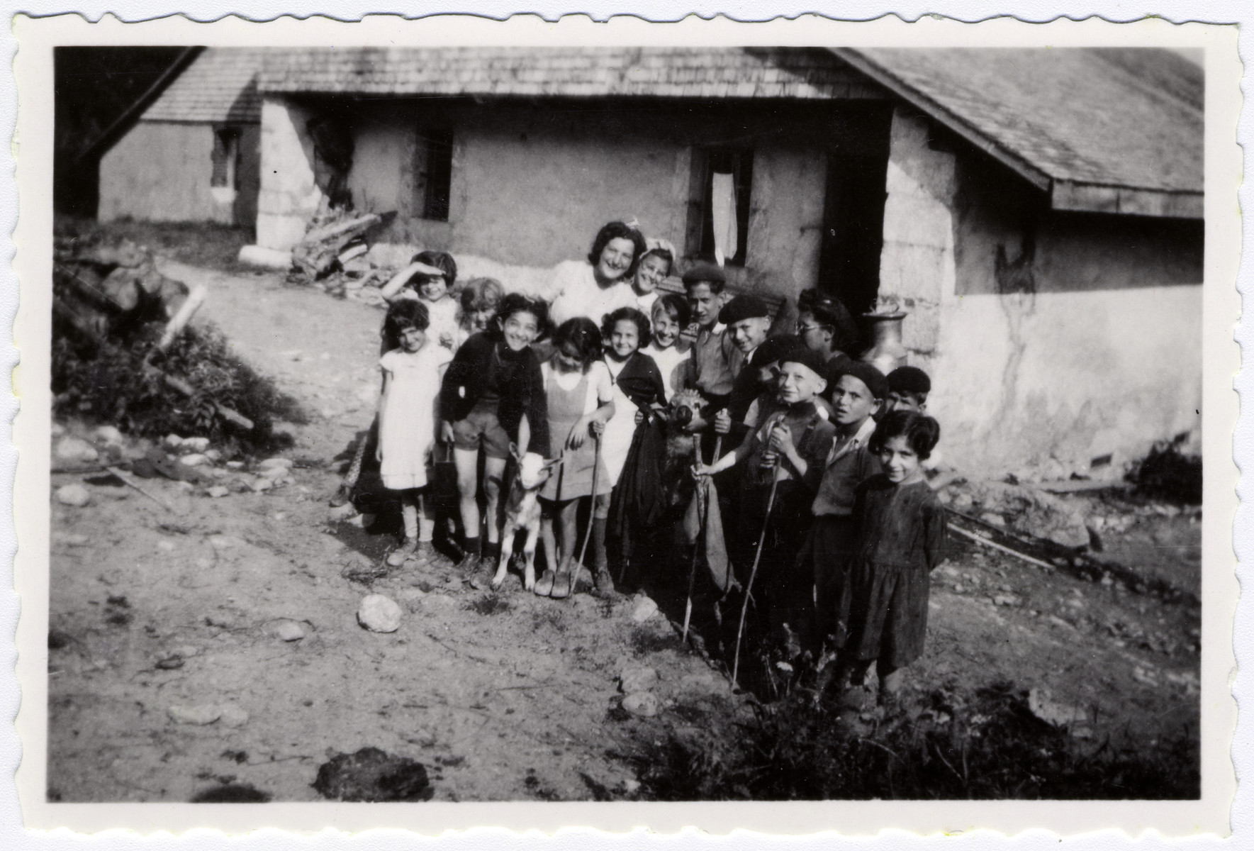 Denise Bloch poses with a group of children in her care [possibly in Perrigueux].