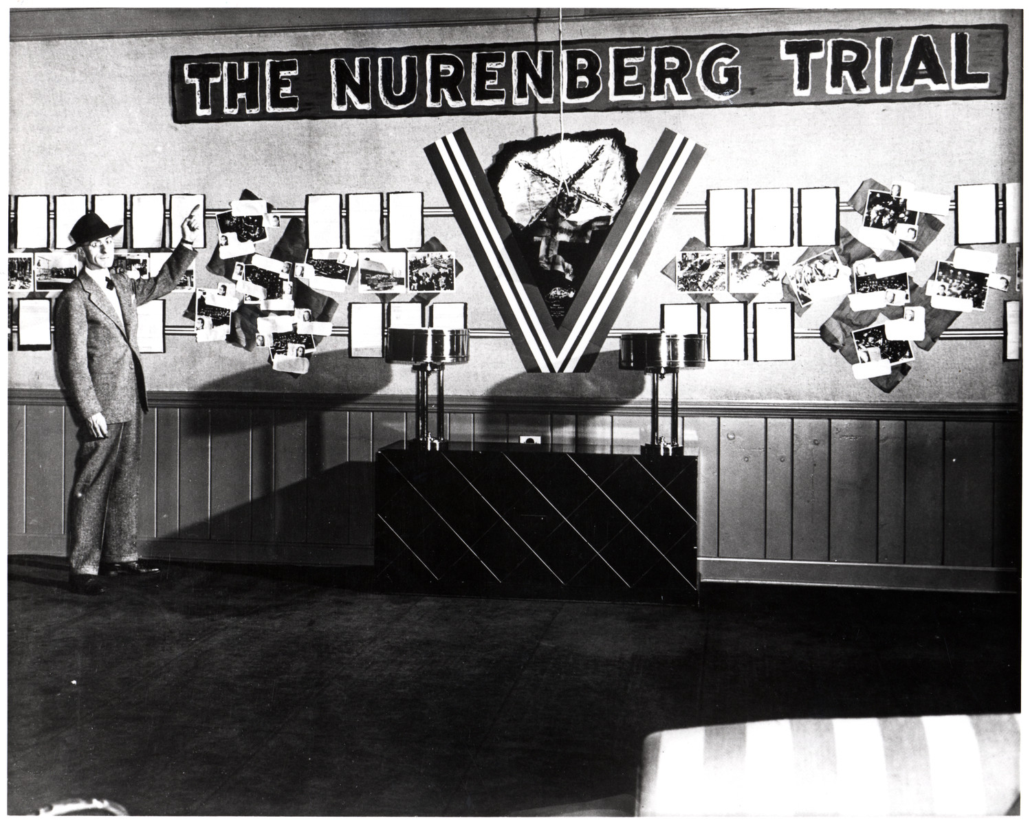 A man points to a diplay of photographs and documents in an exhibition about the Nuremberg Trial.