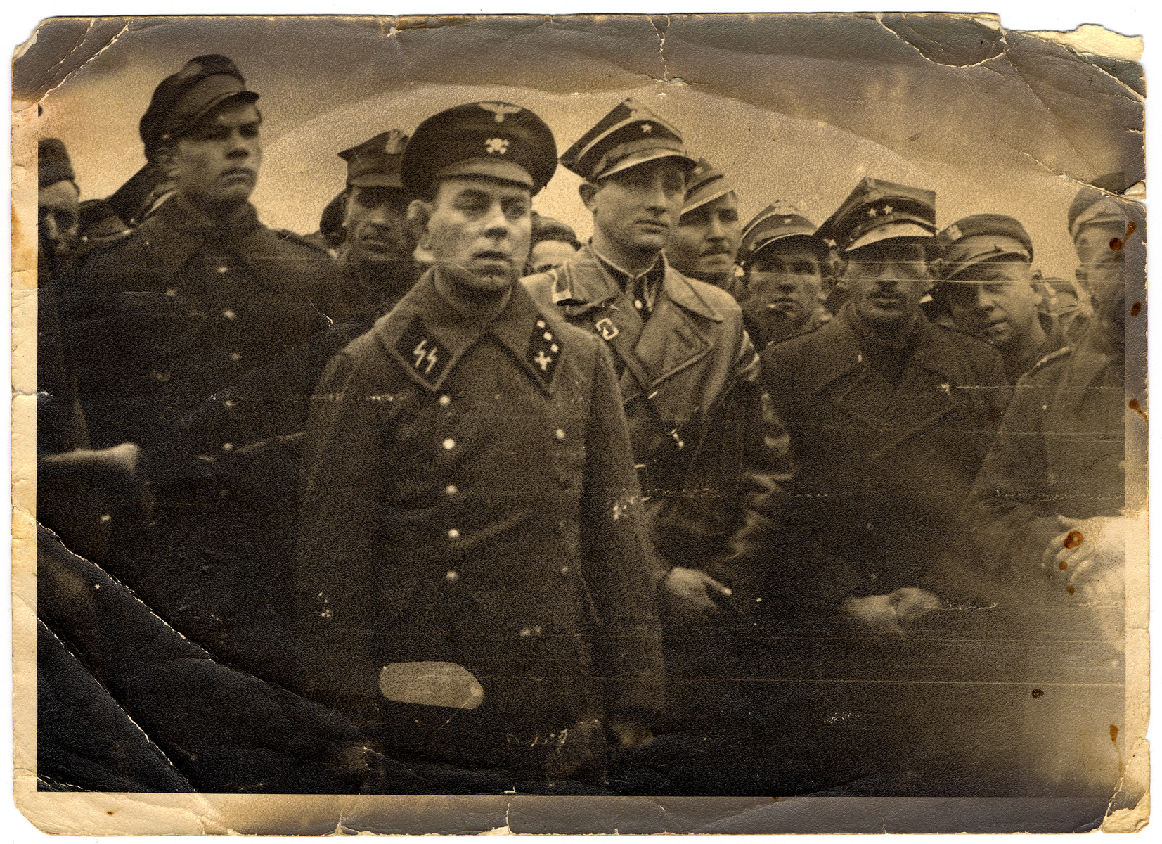Chaim Faber (cousin of the donor) and a Polish Jewish officer in the Red Army participates in the hanging of a camp guard identified as Hoffman.