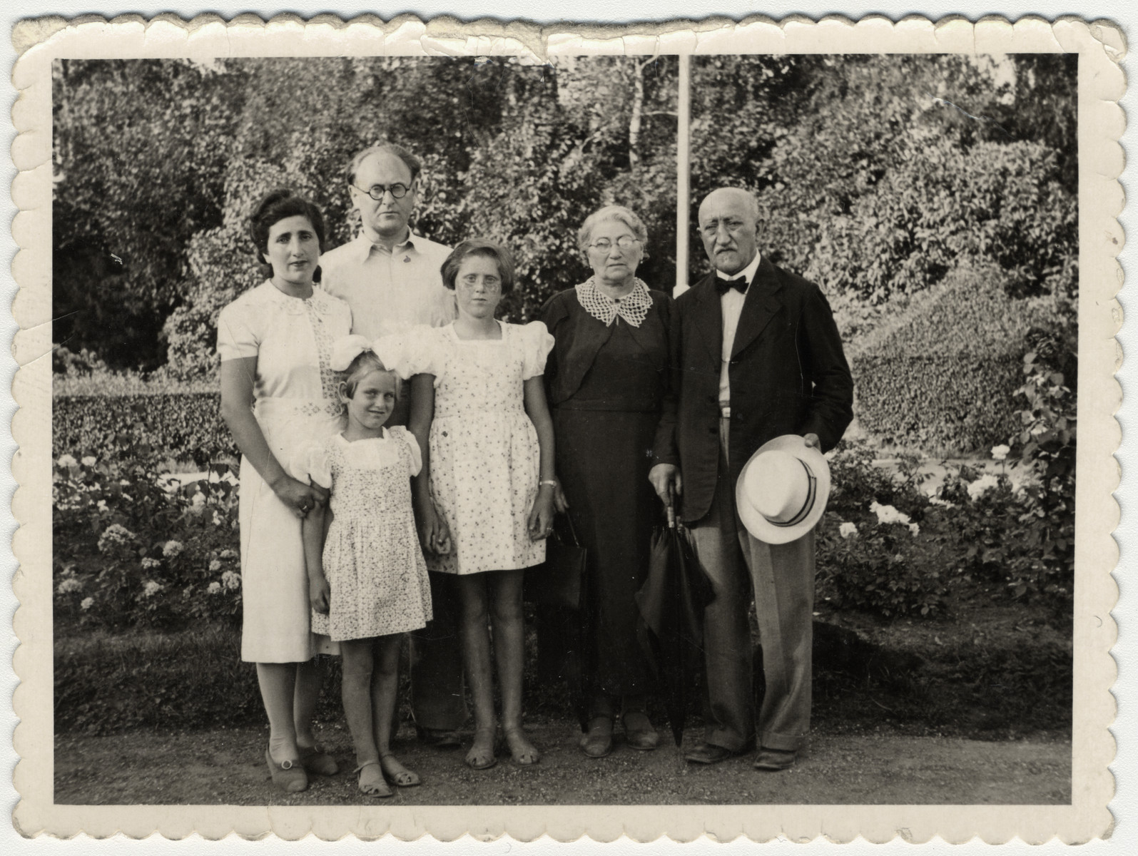 Group portrait of a Latvian Jewish family.  Photographed are Frieda and Arthur Lewenstein with their daughters Libin (left) and Bella (right), and Frieda's parents Bernard and Scheine ('Jenny') Brenner. The family did not survive the Holocaust.