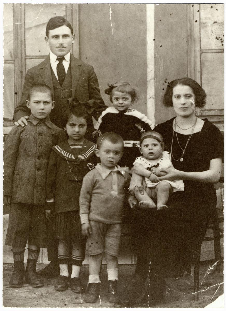 Prewar studio portrait of the Solomon family in Bivolari.  Pictured are Bercu and Sofie Solomon and their five children Henry, Hanna, Reuven, Esther and Haim.