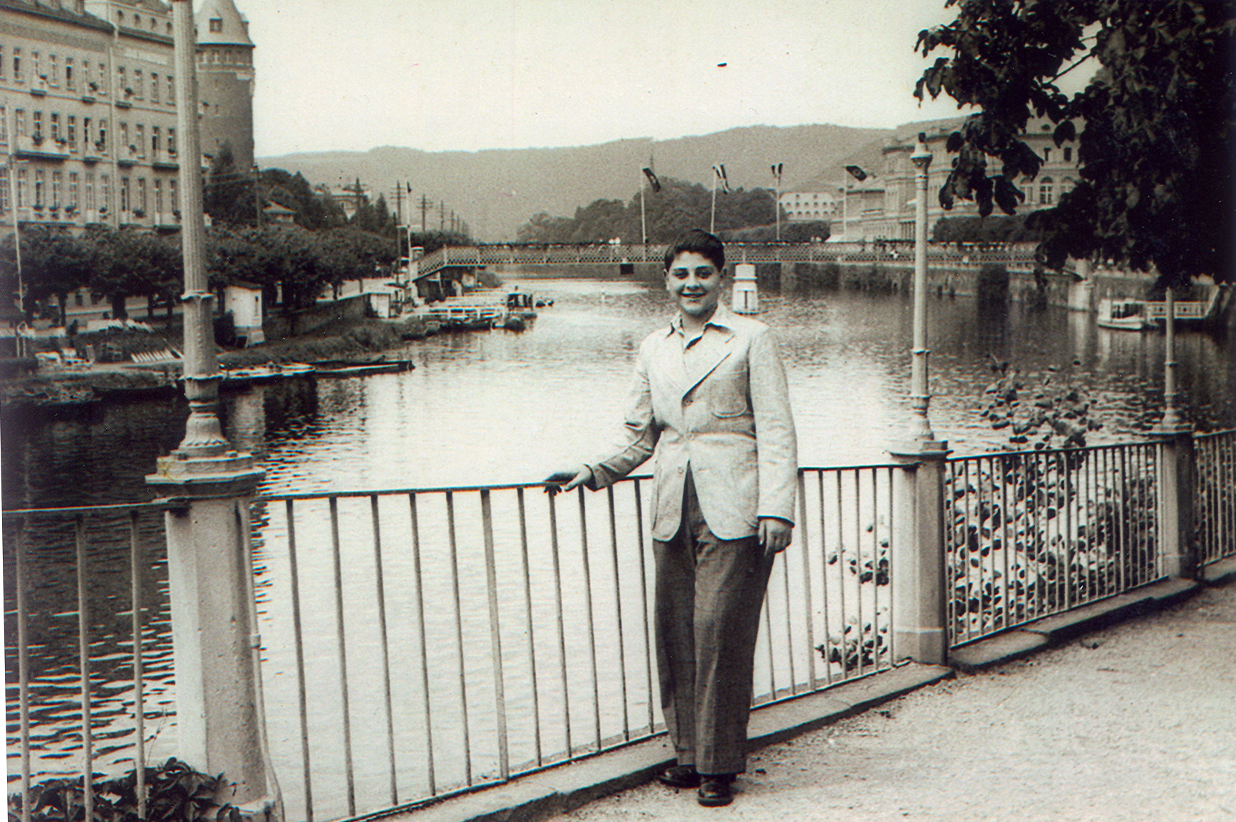 Fred Oppenheimer poses by the railing overlooking the Lahn River.