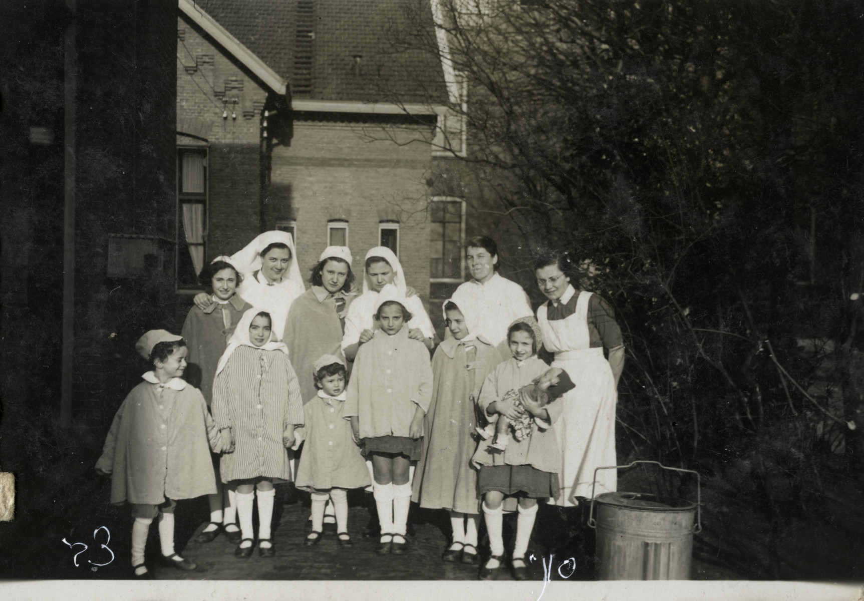 Group portrait of children and nurses in a hospital [probably in Berlin].  Zvi (far left) and Sonni (far right holding a doll) Birnbaum were being treated for diphtheria.