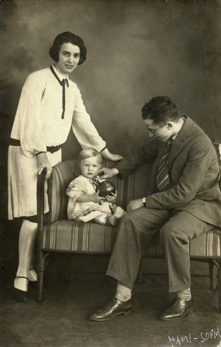 Studio portrait of Hennie and Yehoshua Birnbaum and their baby daughter Sonni.