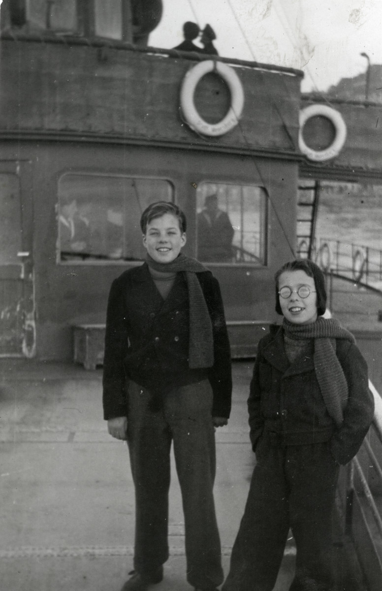 Jacob and Henry Joshua pose on board a boat taking them to St. Gallen after their liberation from Biberach.