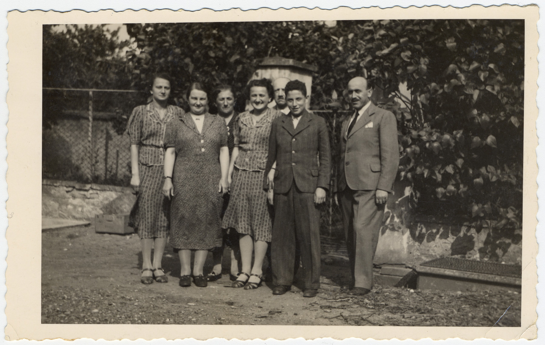 Prewar photograph of the Loewy family in Czechoslovakia and sent to Marianne (Mimi) Loewy in the United States.  Pictured are Irma Treichlinger, Irena Loewy, her cousin Pepa Lorenc and Max Treichlinger (Irma's brother-in-law).  Behind them are Magda Lowey and her parents Guste and Julius Loewy.