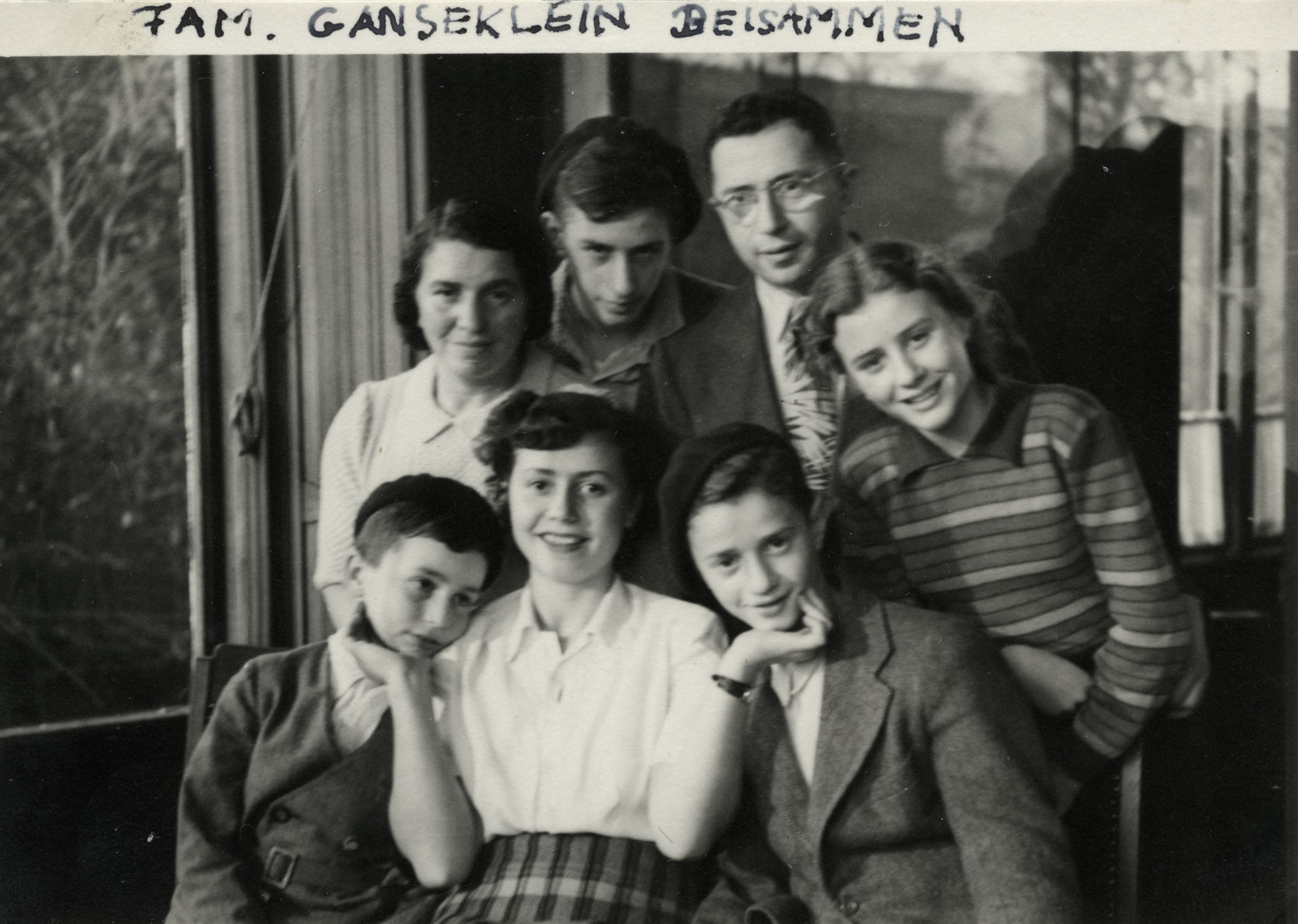 Postwar portrait of the Birnbaum family.  Pictured left to right: seated are Schmuel (Sampi), Regina and Zvi. Standing are Hennie, Yaakov, Yehoshua and Suzy.
