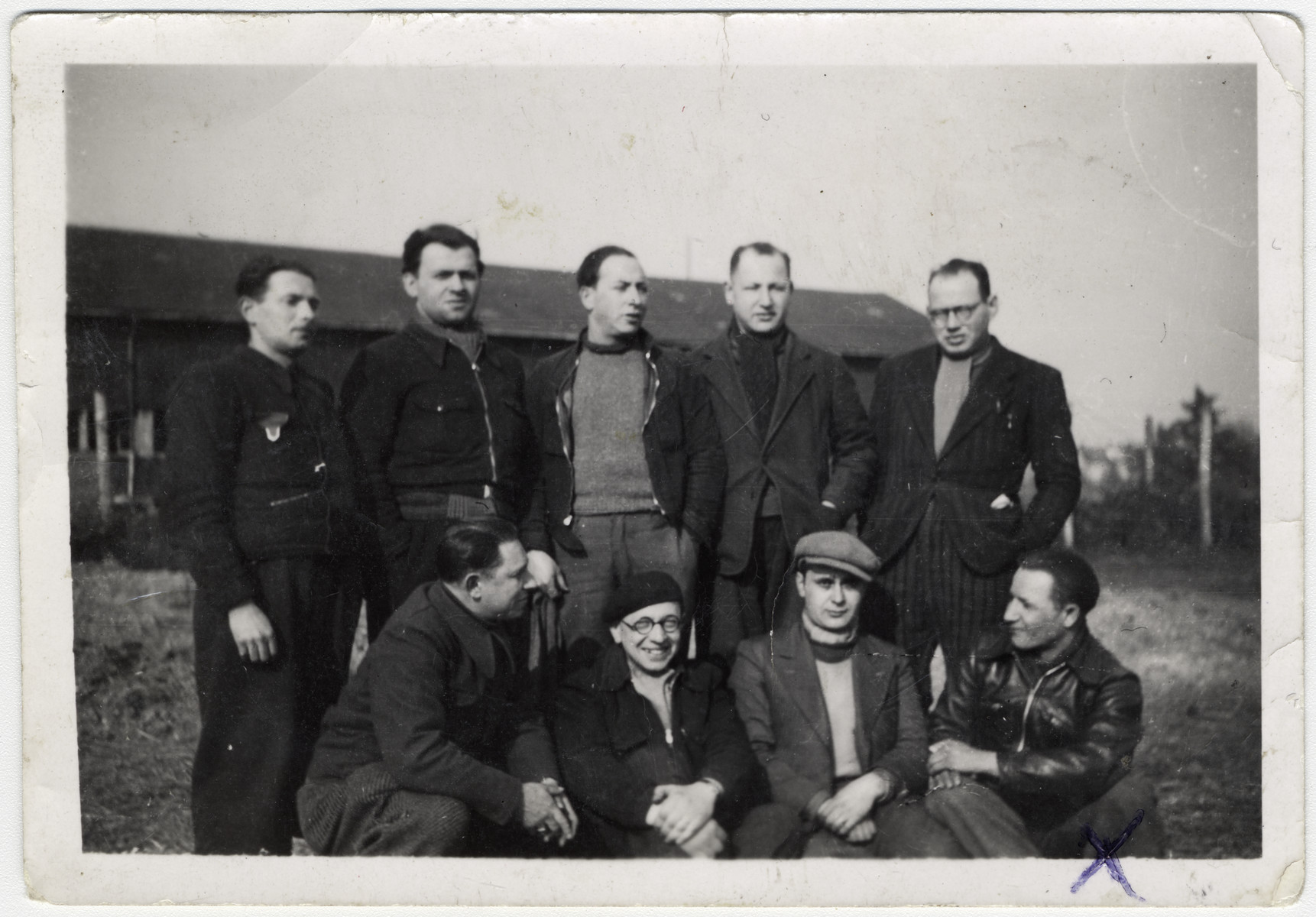 A group of Jewish inmates in the Pithviers transit camp.   Szmul Karpik is visible at the bottom right.