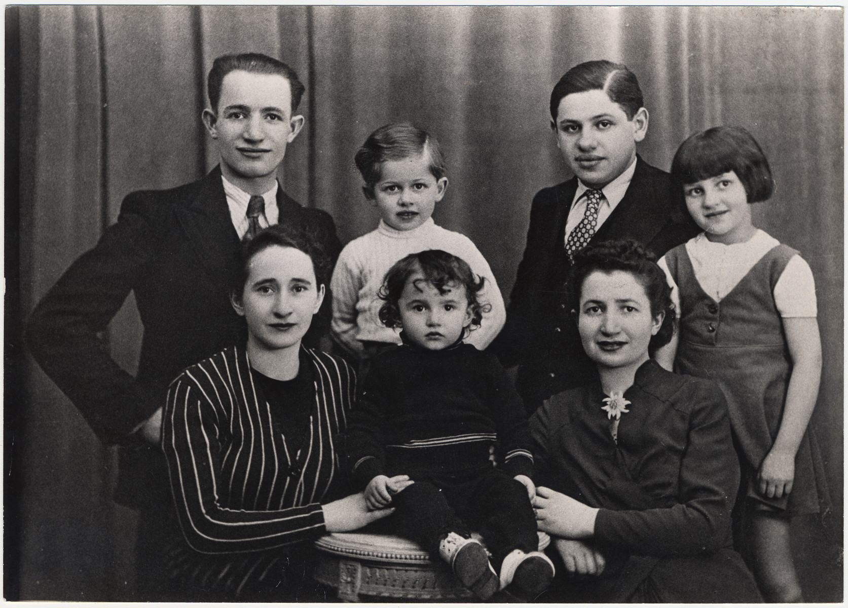 Group portrait of the Karpik family taken shortly after the German invasion of France.  Pictured are Jacques Karpik, with his parents, Szmul and Rojza (nee Taszynowicz) Karpik (left).  Also pictured are his aunt Rivkah Wasserman, uncle Benzion Wasserman and cousin Sarah Wasserman (later Wojakowski).