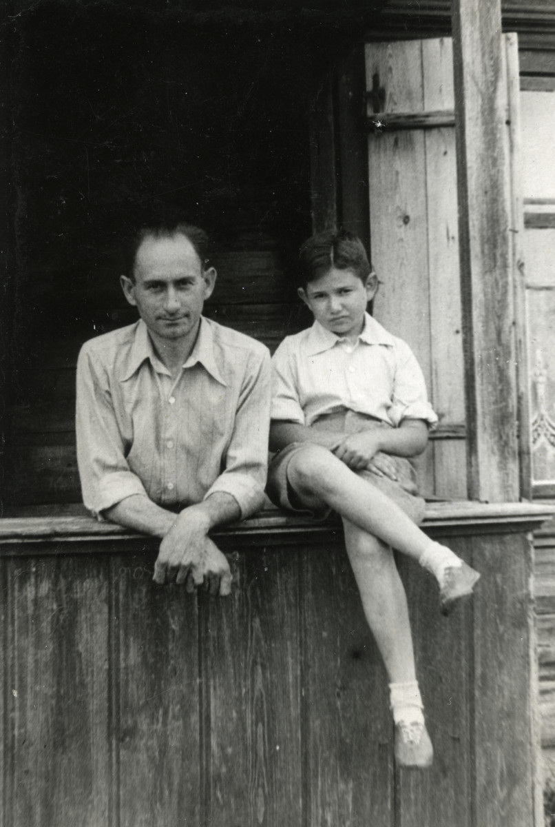 Baruch Rabinovich, and his nephew, Julek Kracowski pose at a window sill.