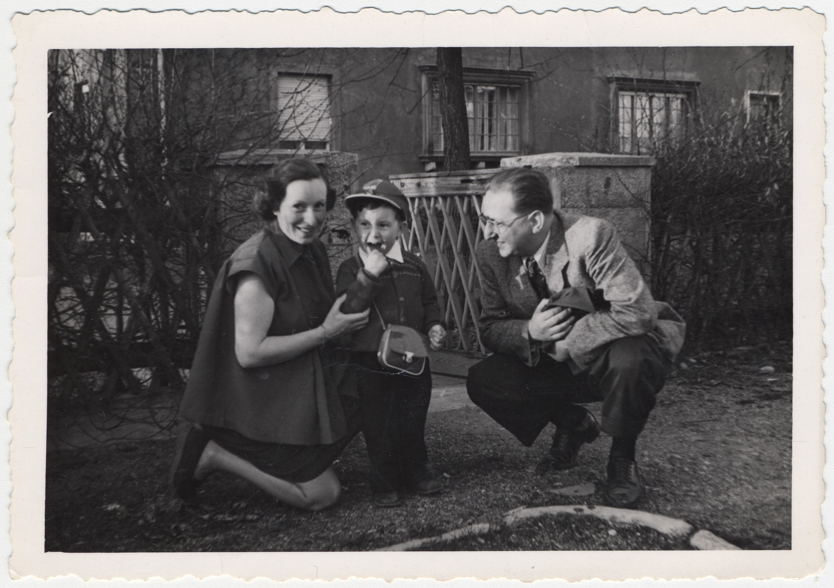 Valerie, Cary and Ernest Lowe pose outside their home in Branau where Ernest was working for American counter-intelligence  The previous occupant had been a German general.