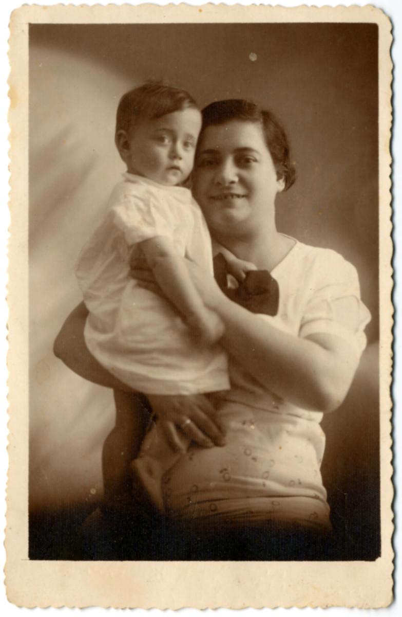 Studio portrait of Rywka Perla Laudon Goldzweig holding her young son, Szaja Symcha.