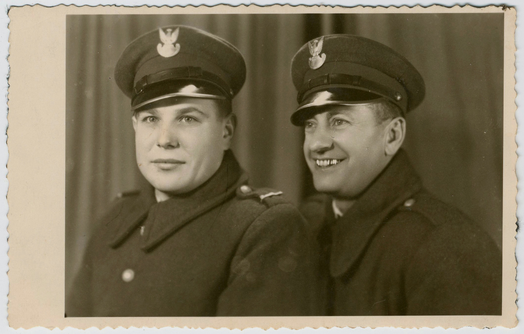 Wolf Laudon (right) poses with a Polish friend; both are members of the Polish police.
