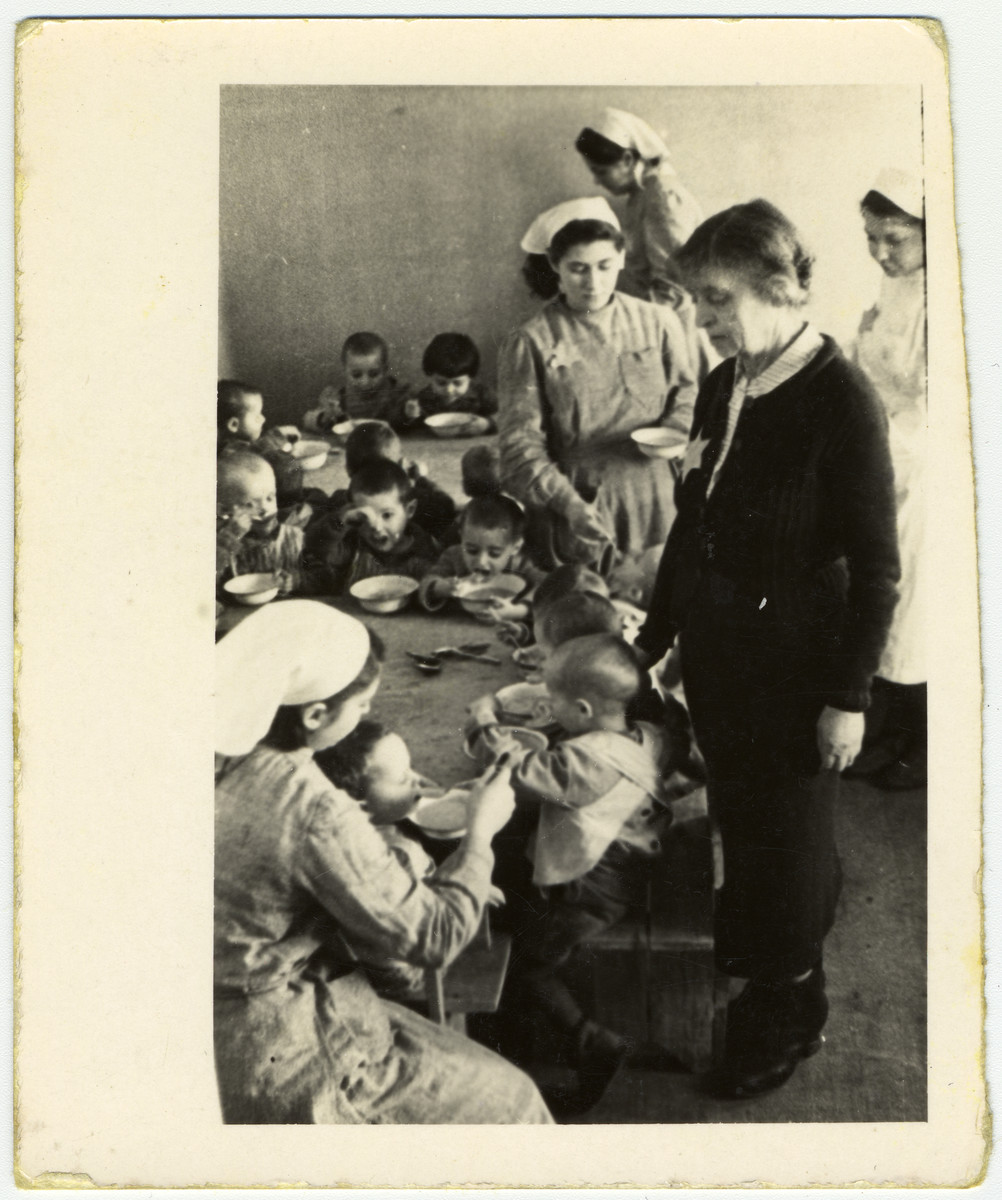 Children eat soup in the pediatrics ward of one of the hospitals in the Lodz ghetto.