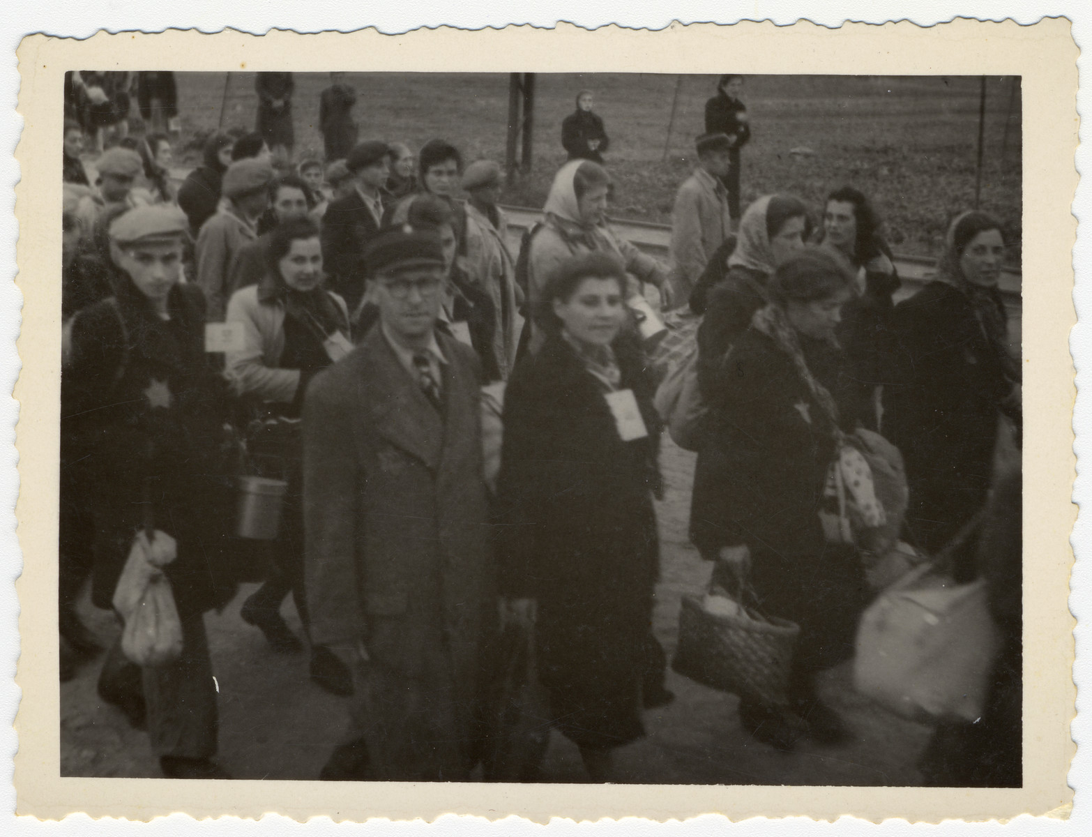 Jewish police escort a column of Jews to an assembly point in the Lodz ghetto.