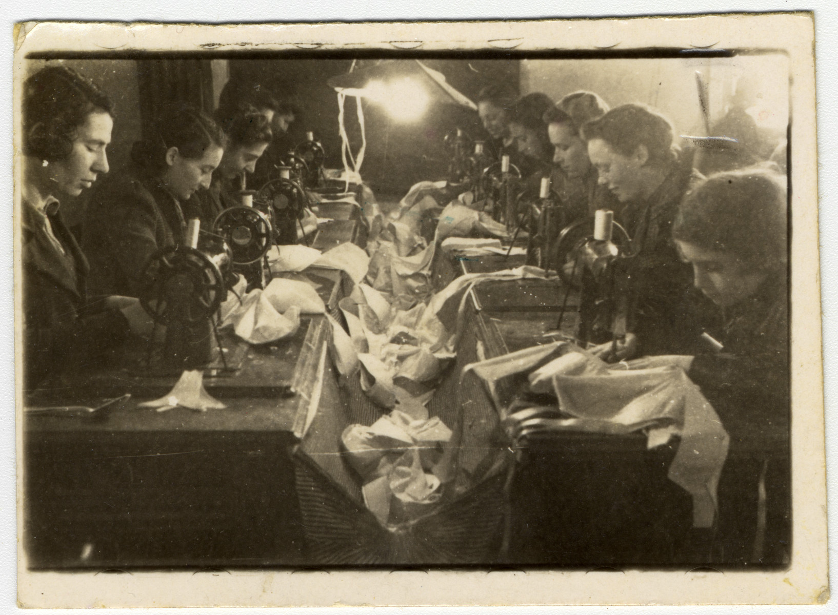 Employees of a sewing workshop in the Lodz ghetto.