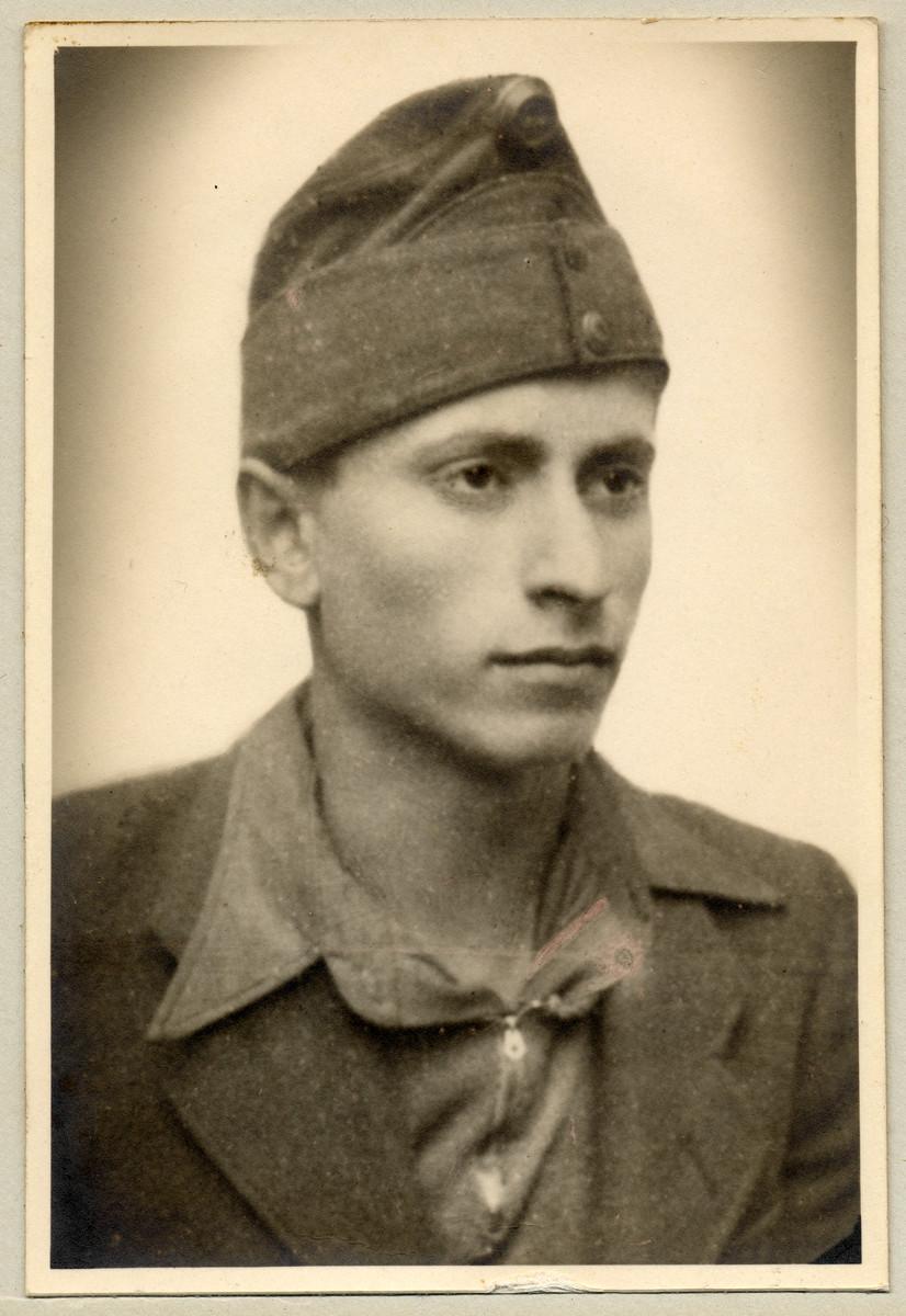 Studio portrait of Marcel Kuttner wearing a military cap.