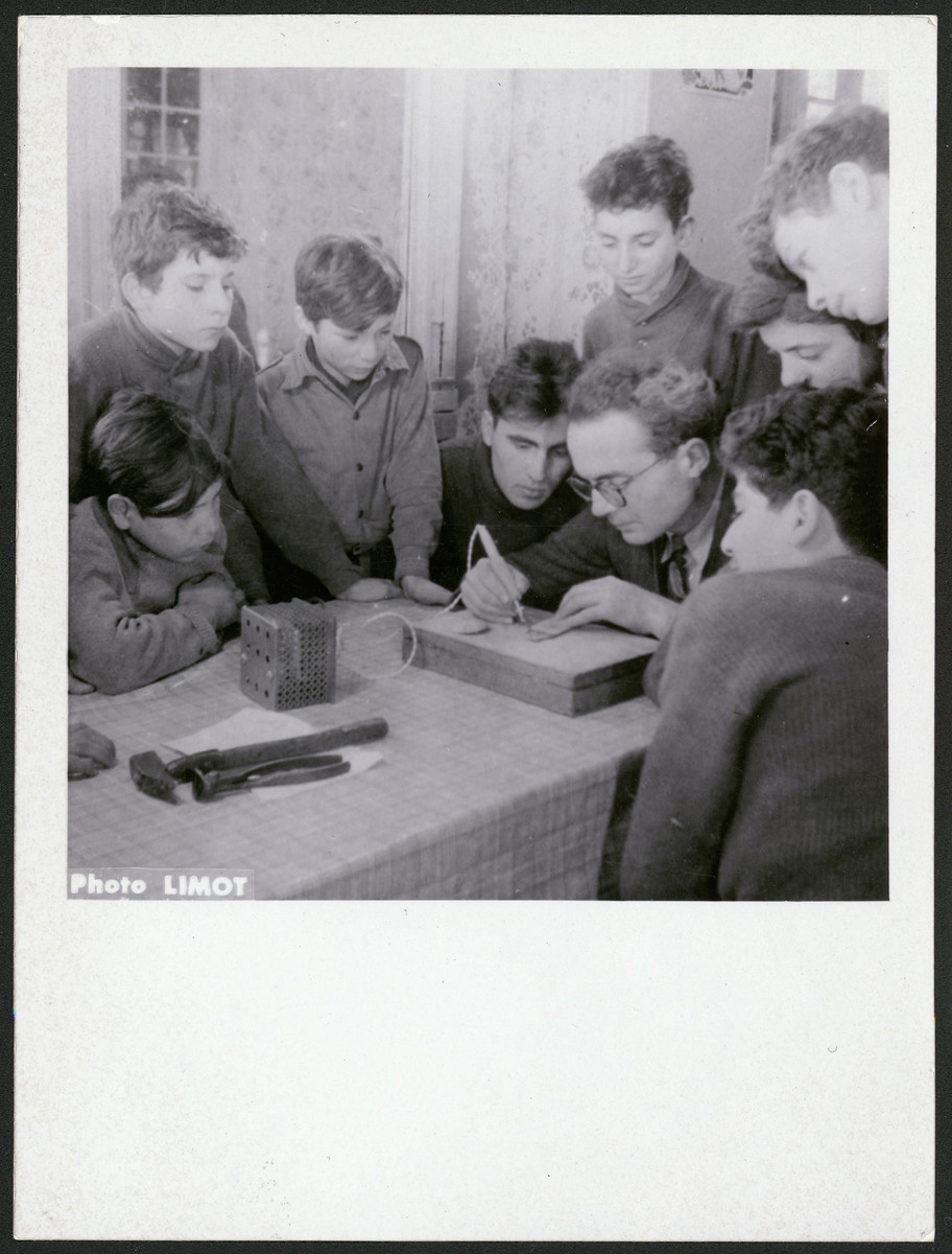 An instructor demonstrates the use of a stylus in a vocational training class in an OSE home in France.