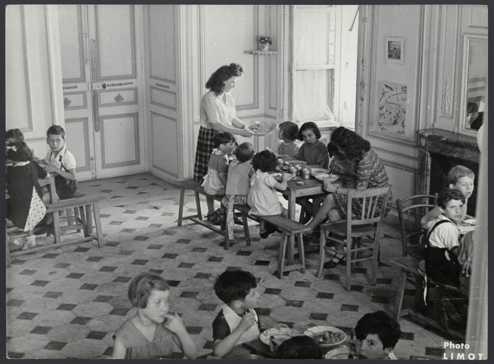 Children eat their mid-day meal in the Chateau de Corbeville, a postwar OSE children's home.