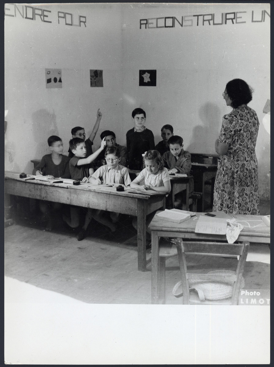 Children study in a classroom in the Masgelier postwar OSE children's home.