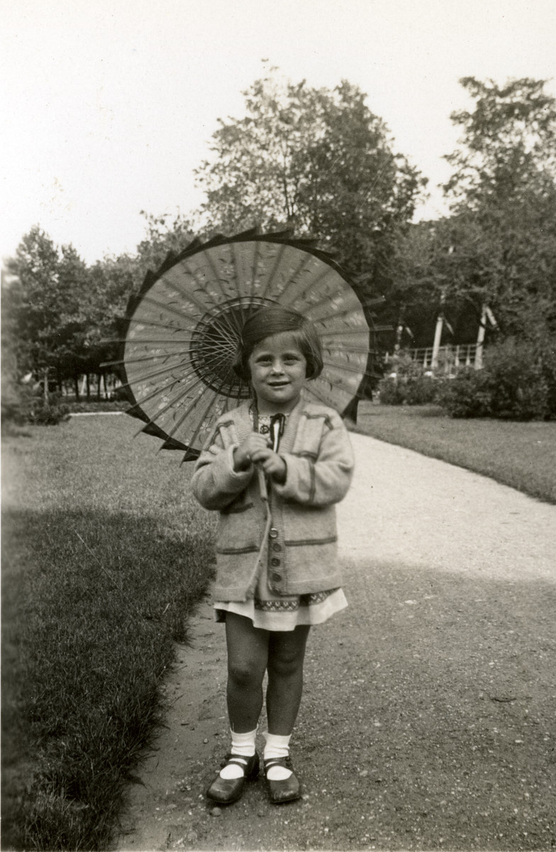 Close-up portrait of Irene Lewitt holding a sun parasol.