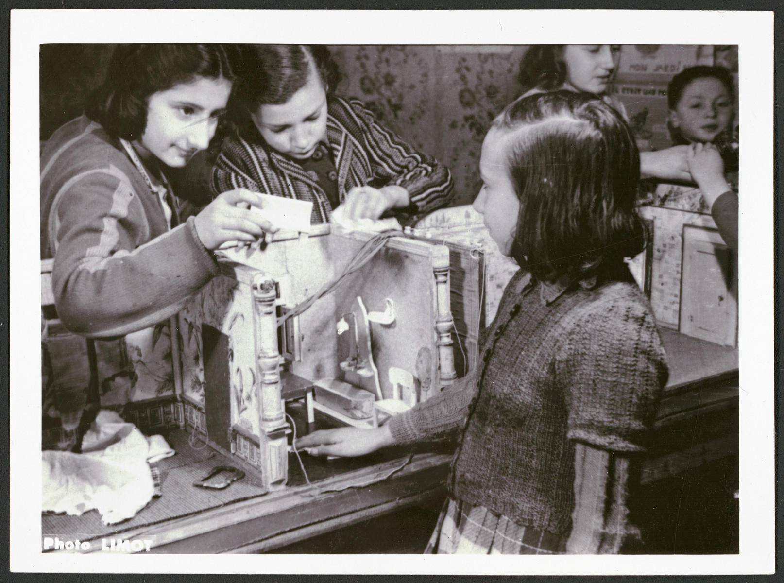 A group of girls builds a doll house in a postwar OSE children's home.
