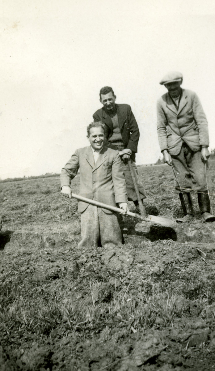 Eli's father, Pal, smiles and holds up his shovel in the trenches on the western border of Hungary.  He is working in forced labor brigade.