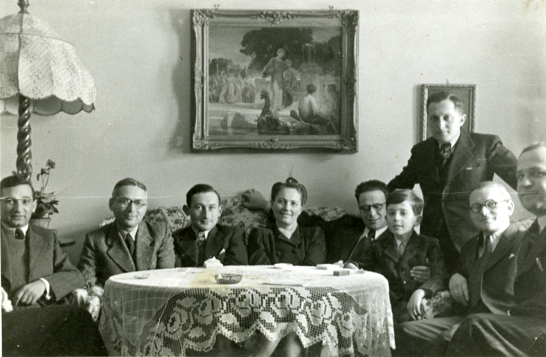 Elie Breuer (the young child) sits with his family in Papa.  His father is at the very right edge of the photo and his mother is in the middle.