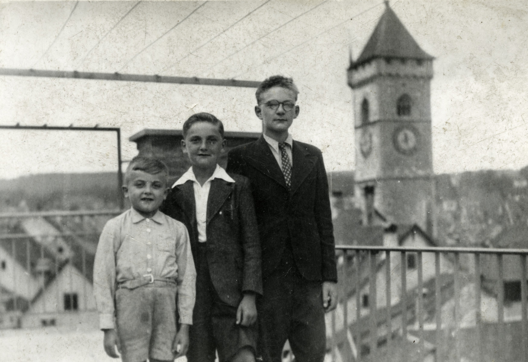 "Shimon, Leon and Hanoch Zeidenbach pose outside the children's home in Switzerland after fleeing to safety.  The original caption reads: ""Pour notre chere soeur Renee."""