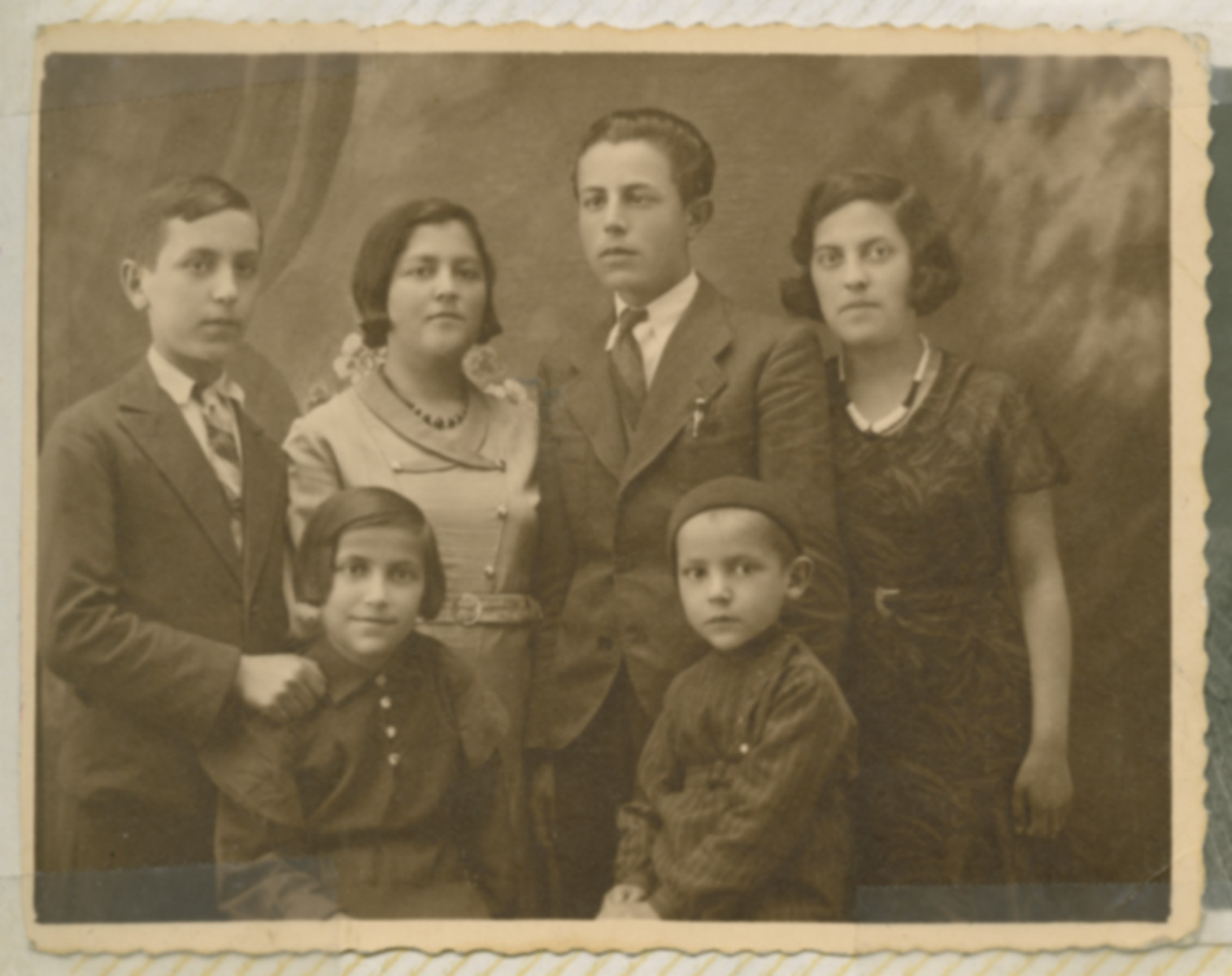 Prewar family photo of the Reichtental family.  Moishe (Marian) Reichental is standing second from the right. Also pictured are his siblings Max, Rafael, Pesa, Rachela and Mila. Pesa and Rafael are the youngest at the forefront.  Rachela is flanked by Max and Marian.