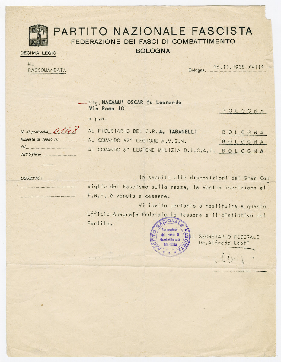 Document issued to Oscar Nacamu terminating his membership in the Facist Party in accordance with the recently passed racial laws.  It states that following the provisions of the Grand Council of Fascism on race, his enrollment in the party has been terminated.  He is required to return his party card and badge.