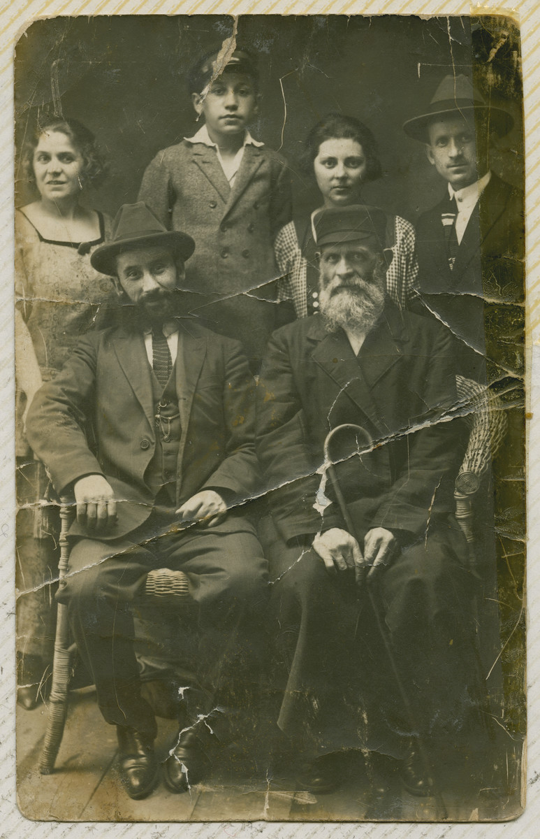 Prewar photo of the Perelmuter family.  From l-r standing are Aunt Sara Landau, her son Feliz Landau, the wife of Uncle Felix Perelmuter, Uncle Felix Perelmuter.  Seated l-r are the husband of Aunt Sara and Grandfather Mendel Perelmuter, owner of the dry good store in Nasielsk.