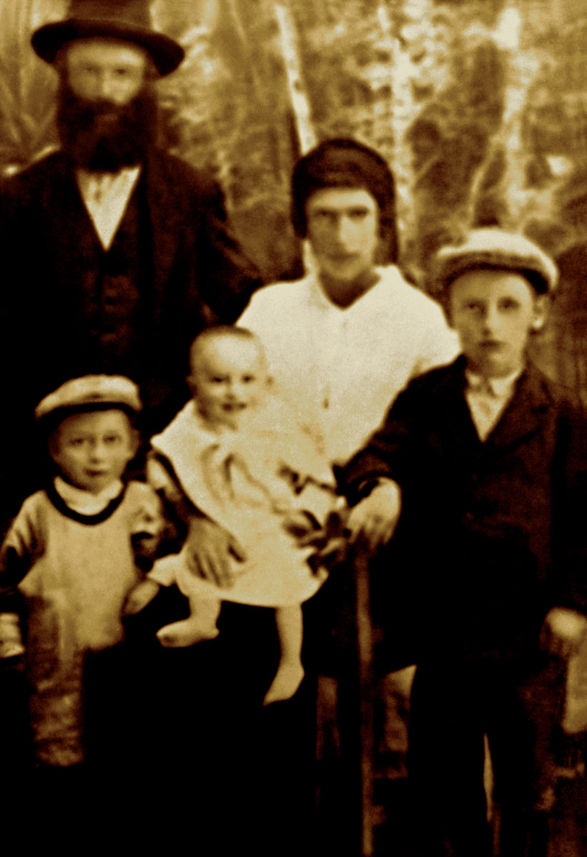 Prewar studio portrait Alexander and Sima Weiss family and their three sons (left to right) Zwi Hersh, Mordechai and Abraham.