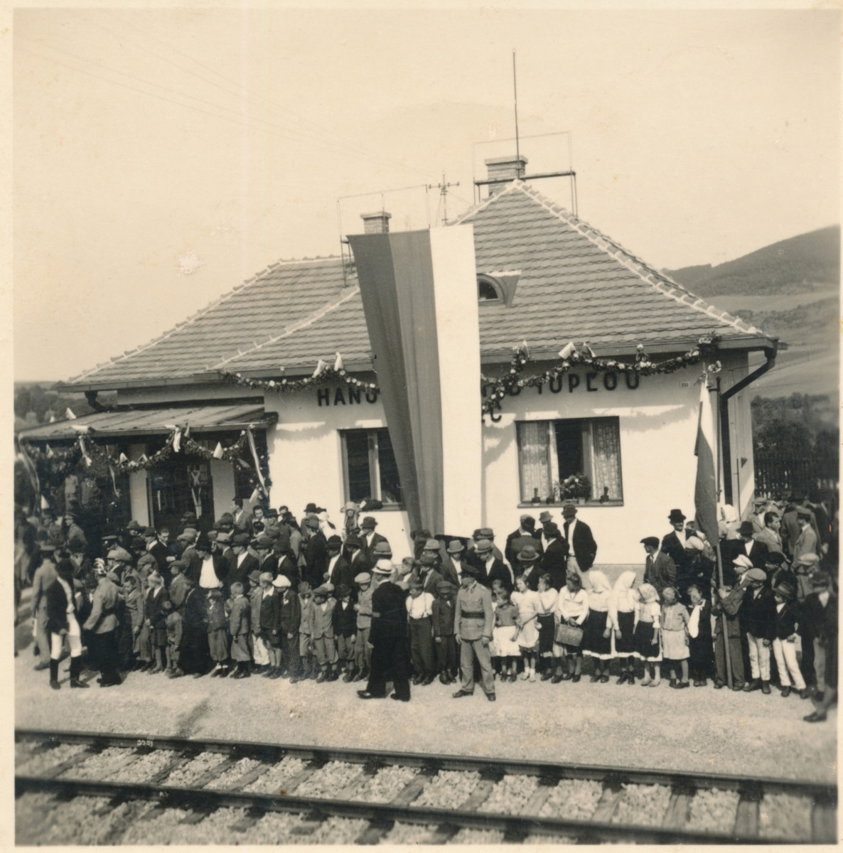 Residents of the town of Hanushovce wait at the train station to greet the arrival of President Jozef Tiiso.