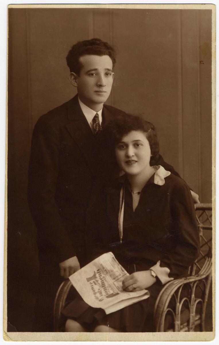 Studio portrait of  Israel Dauerman and his sister Shansha.   Shansha perished in the Holocaust.