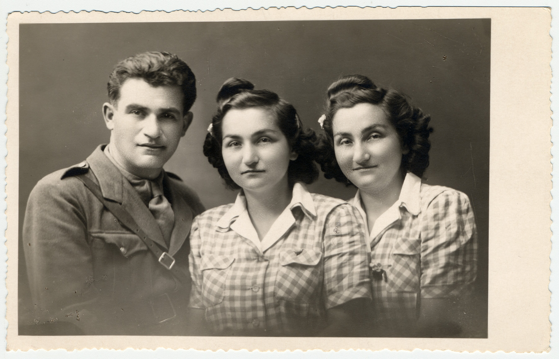 Postwar studio portraif of Pearl and Helen (right) Herskovic who survived the war as Mengele twins and their brother Arno, a soldier in the Czech army.