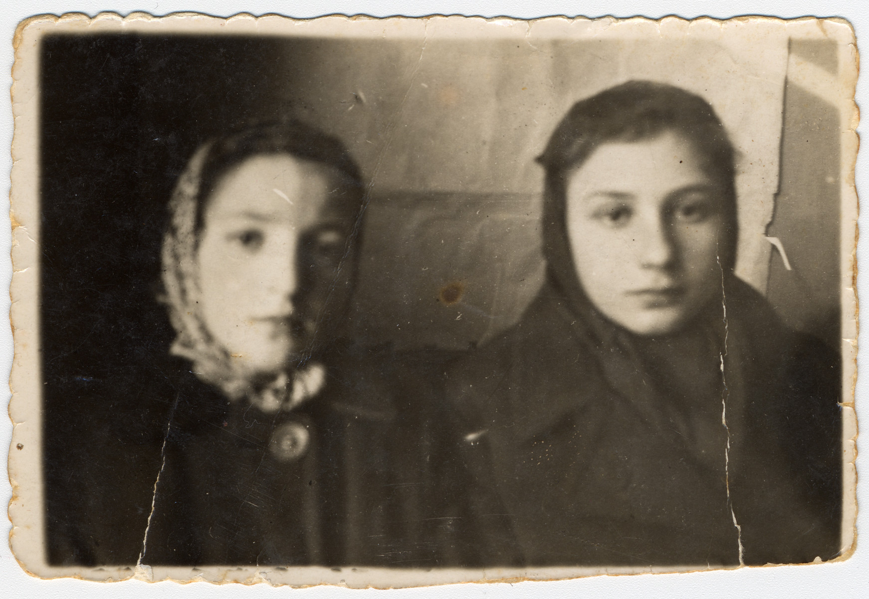 Close-up portrait of Zophia Shulman and her cousin Feiga Monczarz in Kock where they fled after the liquidation in Serokomla.