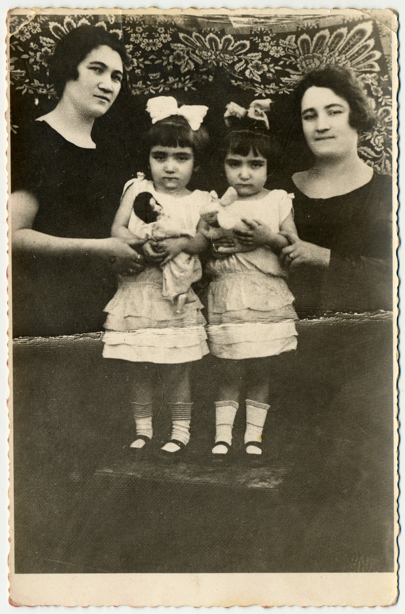 Studio portrait of the four Herskovic sisters.  From left to right are Emilia, Helen, Pearl and Miriam.