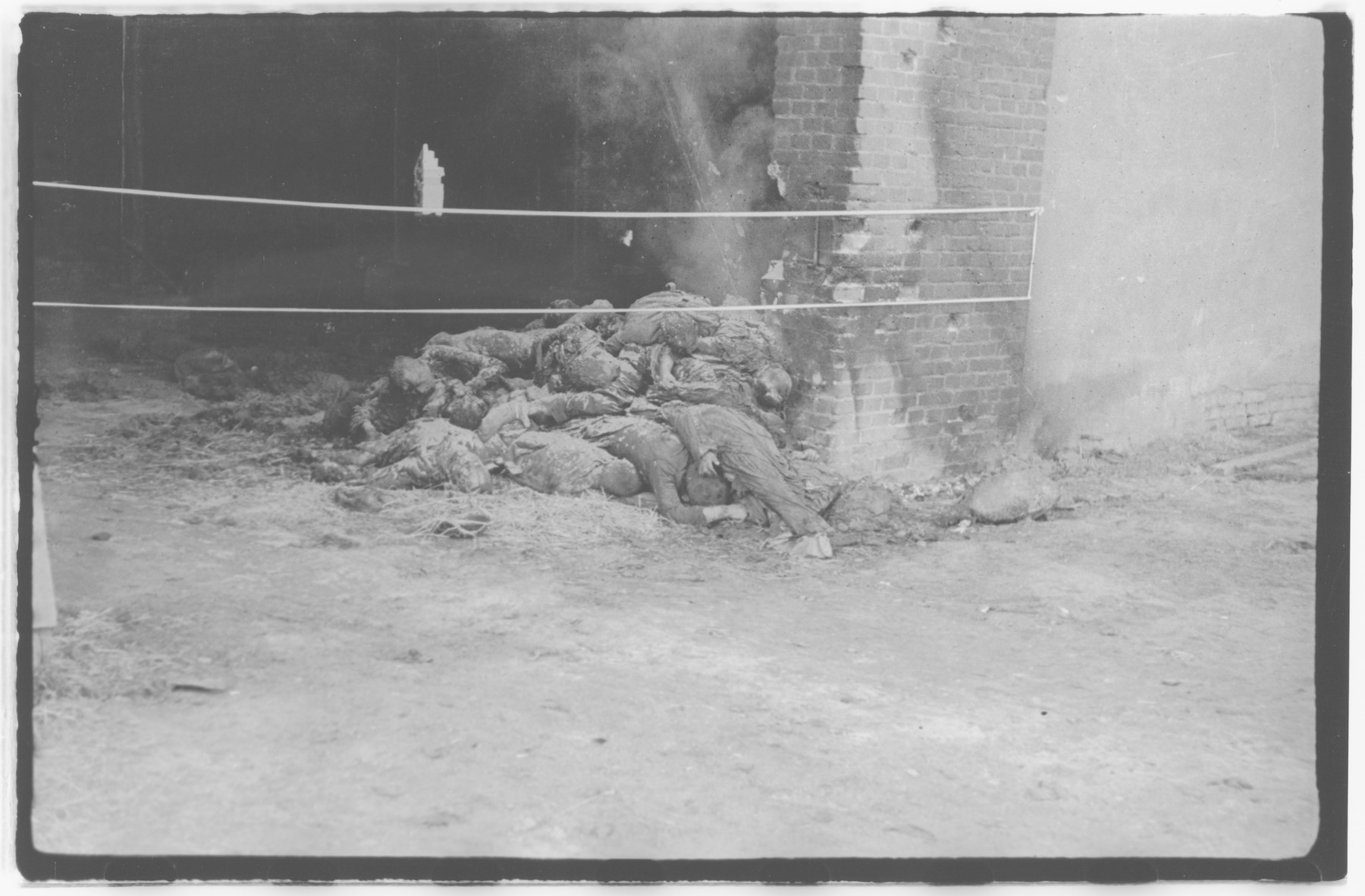 A pile of burned corpses, victims of the Gardelegen Atrocity,are roped off in the barn where they were discovered