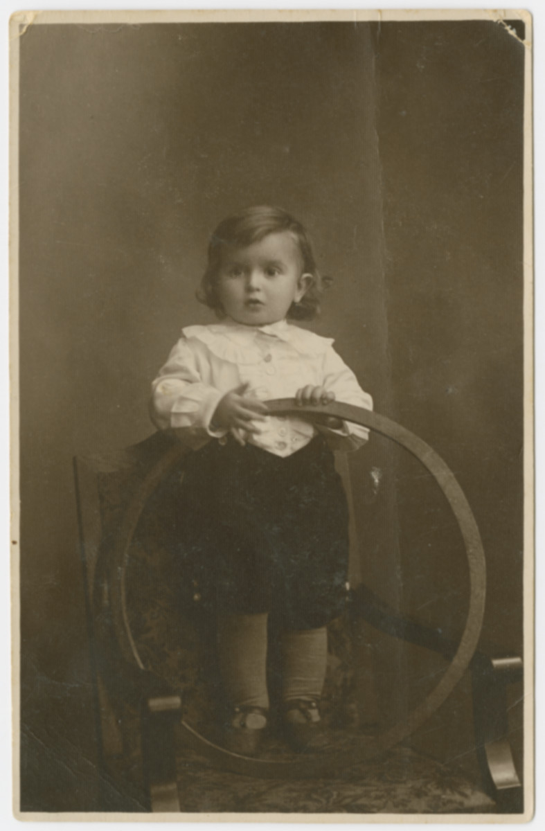 Studio portrait of a young Jewish child identified as Hinda's son.