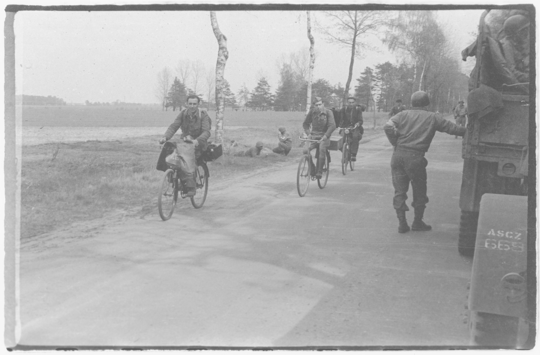 US Army officers from the 91st Evacuation Hospital Unit ride their bicycles.