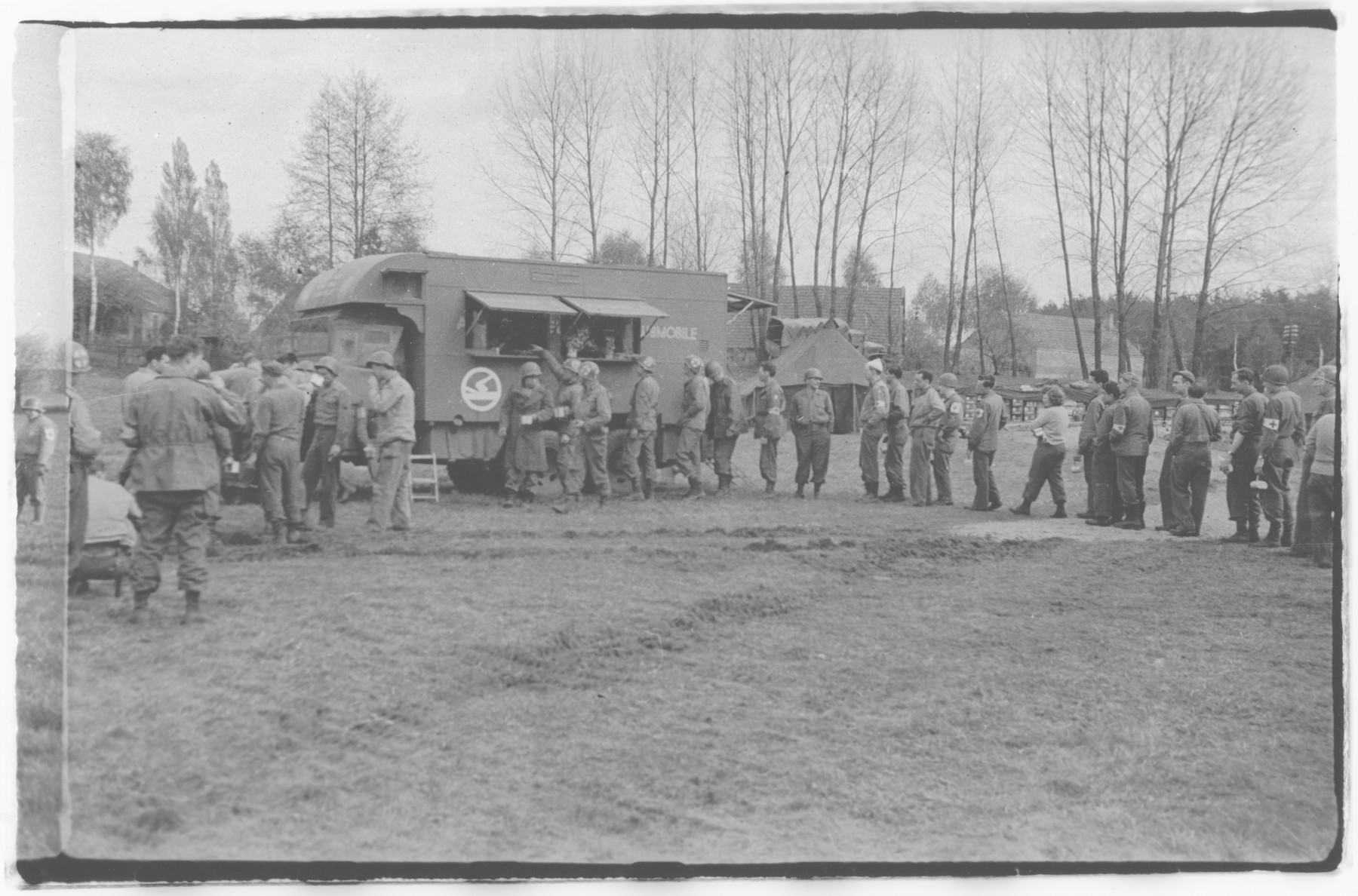 US Army Officers From The 91st Evacuation Hospital Unit Stand In Line For Food