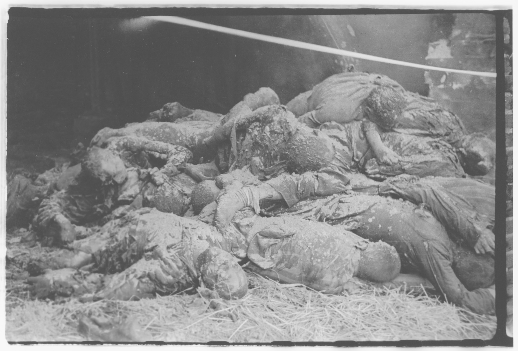 A pile of burned corpses, victims of the Gardelegen Atrocity, lie piled in a barn.