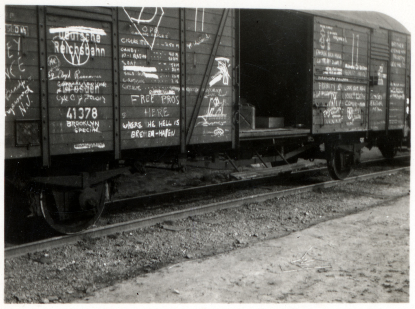 View of a cattle car used by American GIs and covered with their graffiti.