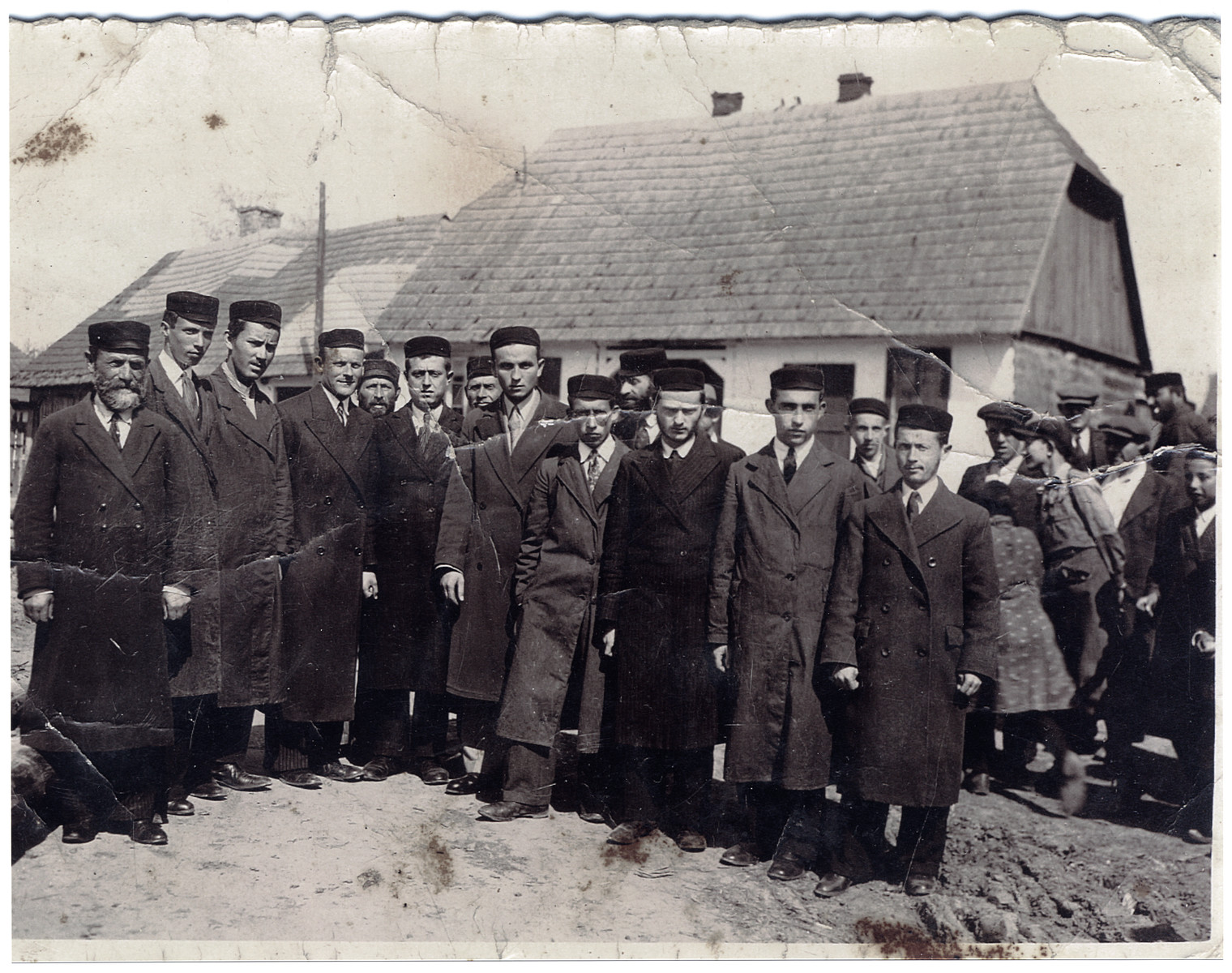 Group photograph of Chassidic Jews in the town of Wachok, Poland.    Among those pictured are Mendel Lustman (far right) and his brother Pinchas Lustman (fourth from the right).
