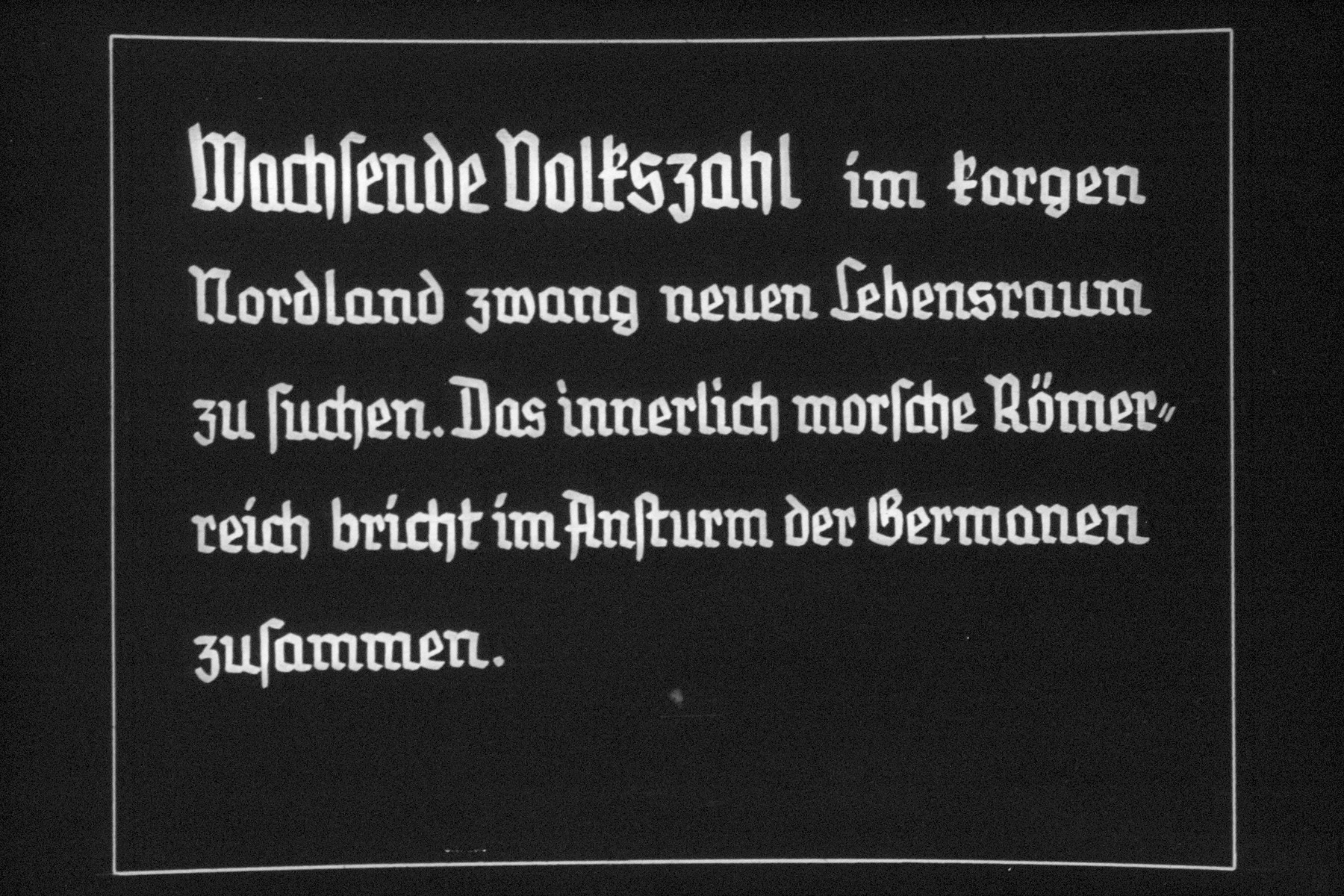 "25th Nazi propaganda slide for a Hitler Youth educational presentation entitled ""5000 years of German Culture.""  Wachsende Volkszahl im kargen Nordland zwang neuen Lebensraum zu suchen. Das innerlich morsche Römerreich bricht im Ansturm der Germanen zusammen. // [The] growing population in the baren North was forced to look for a new living space. The Roman Empire, rotting from within, collapsed during the German onslaught."