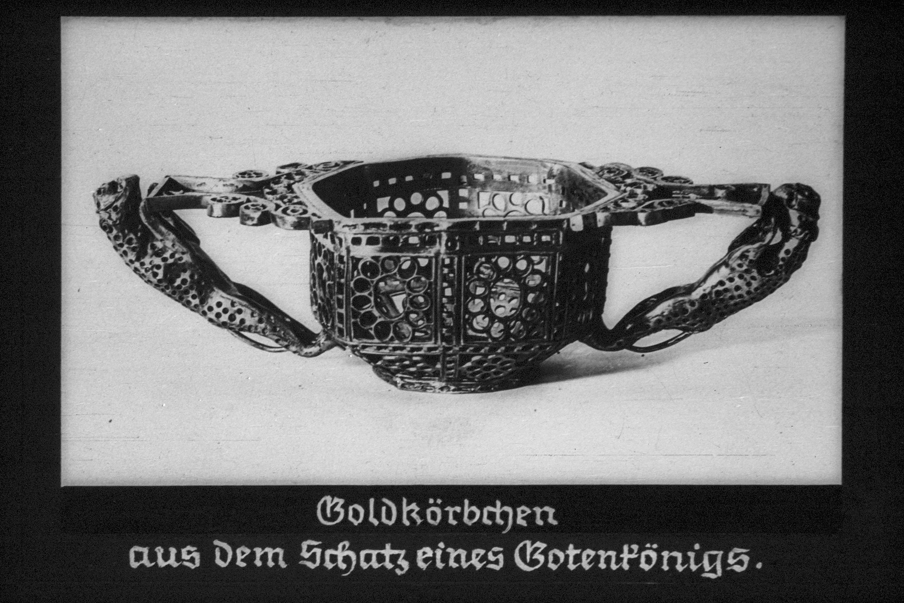 """34th Nazi propaganda slide for a Hitler Youth educational presentation entitled """"5000 years of German Culture.""""  Goldkorbchen aus dem Schatz eines Gotenkönigs // A gold basket from the treasure of a Gothic king"""