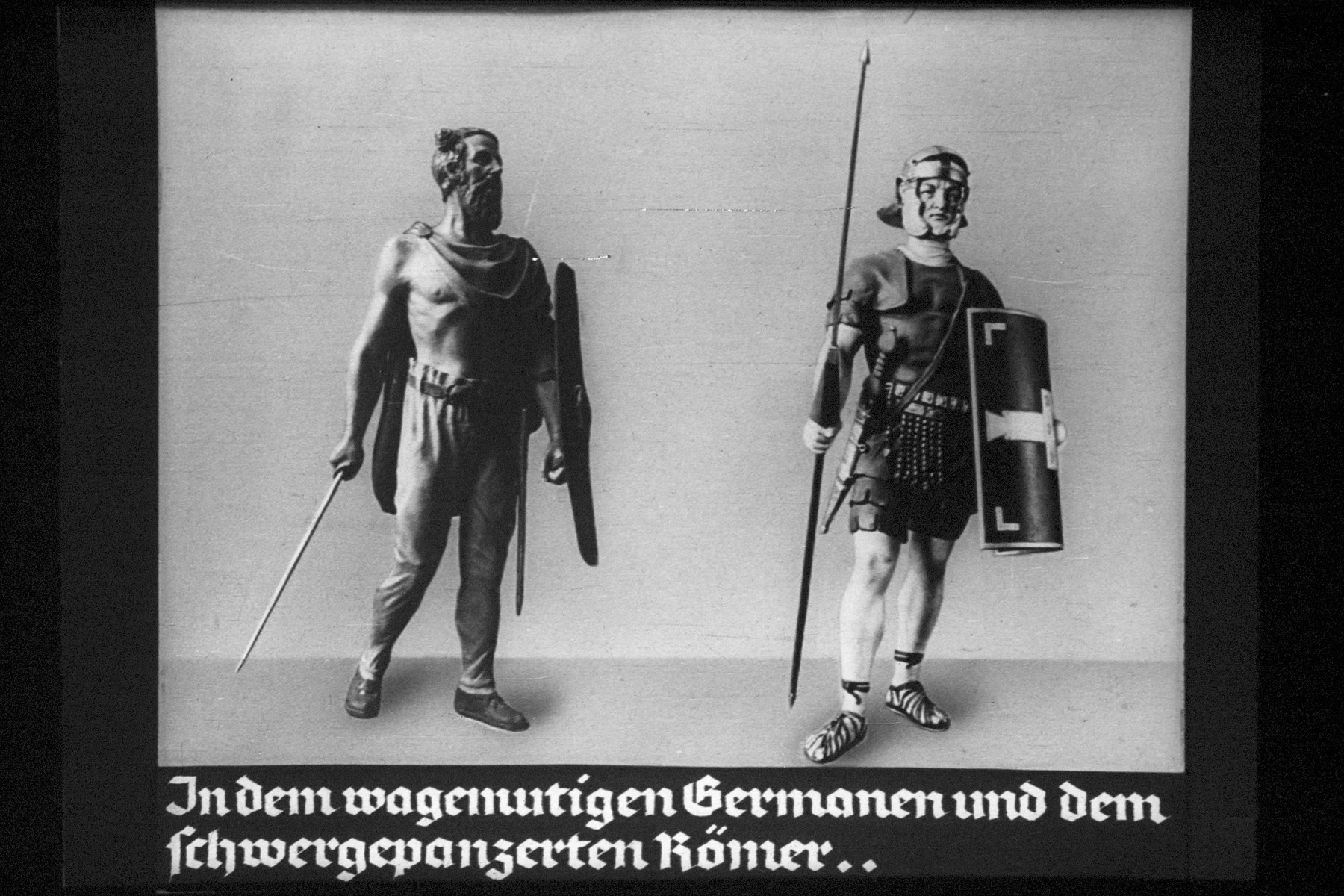 "27th Nazi propaganda slide for a Hitler Youth educational presentation entitled ""5000 years of German Culture.""   In dem wagemutigen Germanen und dem schwergepanzerten Römer.. // The daring Germans and the heavily armored Romans .."
