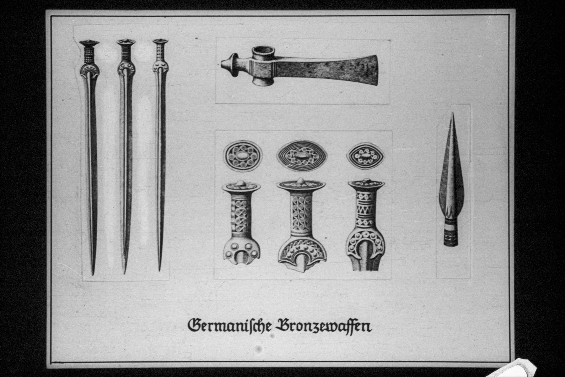 "17th Nazi propaganda slide for a Hitler Youth educational presentation entitled ""5000 years of German Culture.""  German-made bronze tools"